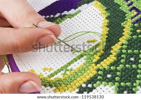 The process of working on a piece of embroidery, close-up - stock photo