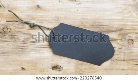The product black label on wood texture  - stock photo