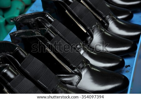 The production of shoes. The Shoe factory. The process of making shoes. The process of making shoes.