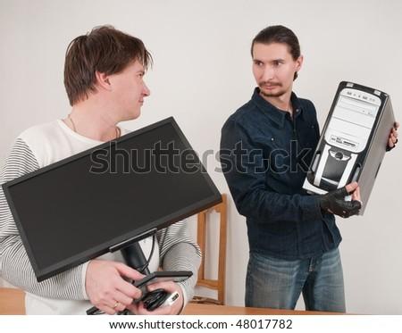 The programmer, the programmer, the adjuster - prestigious man's operation. - stock photo