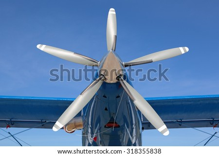 The propeller of a light plane on blue sky background - stock photo