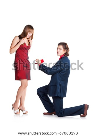 The proposal to woman in red dress  on the knees on white background