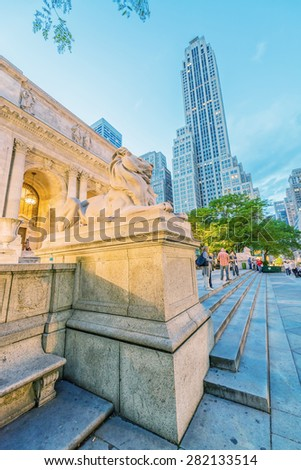 The Public Library and Fifth Avenue at sunset, Manhattan - New York City. - stock photo