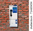 The Public phone isolated on brick wall background - stock photo