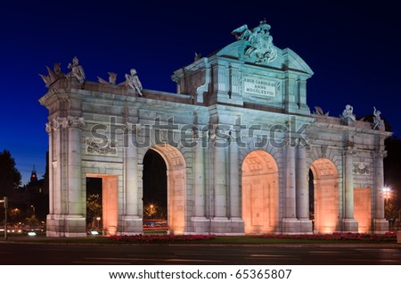 "The Puerta de Alcala is a monument in the Plaza de la Independencia (""Independence Square"") in Madrid, Spain.  It was commissioned by King Carlos III, with construction beginning in 1778."