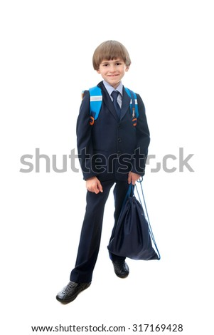 The pupil with a backpack and a bag for a footwear