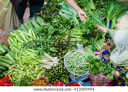 The purchaser takes the product from the seller at the vegetable market - stock photo