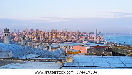 The purple sunset beams on the old city of Istanbul with the domes of Suleymaniye Burial Complex on the foreground, Turkey. - stock photo