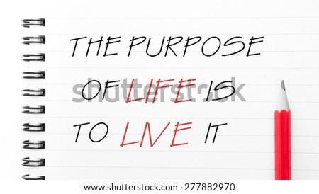 The Purpose of Life Is To Live It Text written on notebook page, red pencil on the right. Motivational Concept image