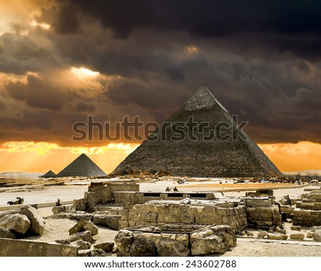 The pyramid of Cheops in Giza in the sunny day, Cairo, Egypt - stock photo