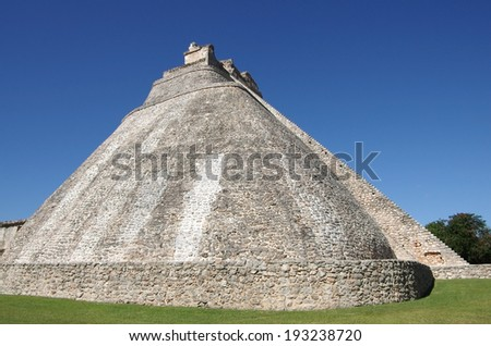 The Pyramid of the Magician (El Adivino) is the central structure in the Maya ruin complex of Uxmal, Mexico - stock photo