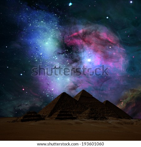 The pyramids in night. Elements of this image furnished by NASA. - stock photo