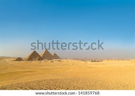 The pyramids of Giza, Cairo, Egypt;  the oldest of the Seven Wonders of the Ancient World, and the only one to remain largely intact - stock photo