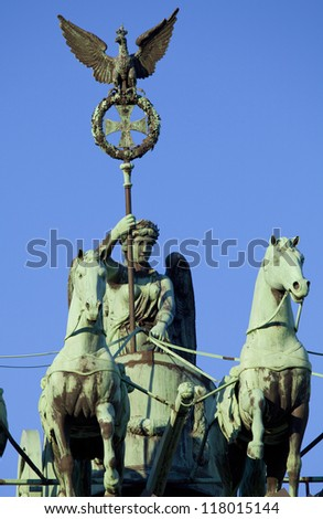 The quadriga on the Brandenburg Gate in Berlin, Germany. - stock photo