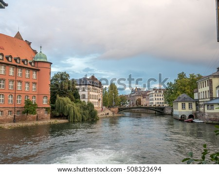 The quarter's weirs and half-timbered buildings with unrecognized tourists in Petite France area in Strasbourg, France
