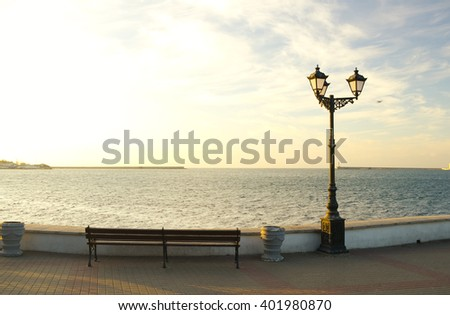 The quay of the the seaside city on a sunset - stock photo