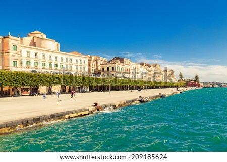 the quayside of an old town of Siracusa located on the island Ortigia - stock photo