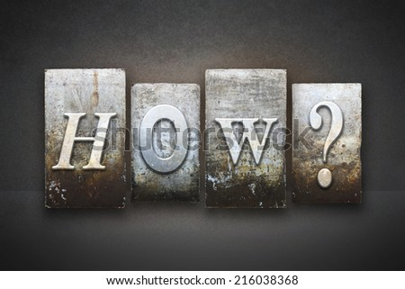 The question HOW? written in vintage letterpress type - stock photo