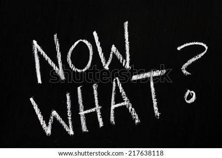 The question Now What? written by hand in white chalk on a blackboard - stock photo
