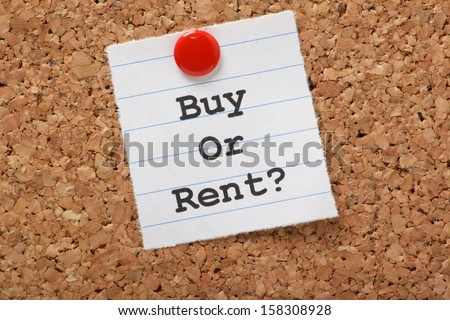 The question to Buy or Rent? typed on a scrap of lined paper and pinned to a cork notice board. A decision aided by analysis of the real estate market and our personal finances. - stock photo