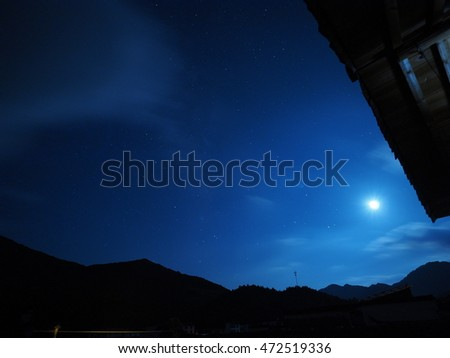 The Quiet And Beautiful Night Sky With Stars Moon Floating Clouds In Summer