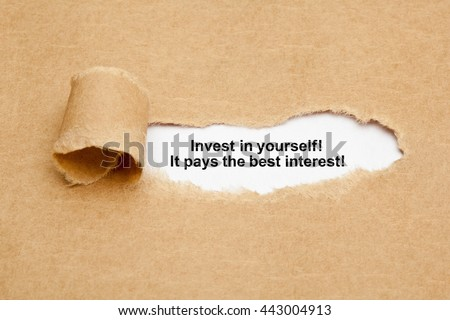 The quote Invest in yourself, it pays the best interest, appearing behind ripped brown paper.
