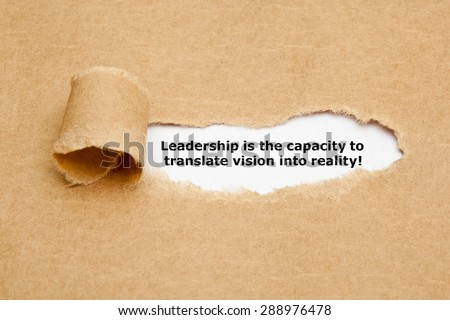 "The quote ""Leadership is the capacity to translate vision into reality"" appearing behind torn brown paper."
