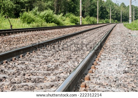 The railway line passing away into the distance - stock photo