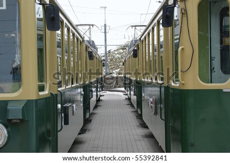 The railway platform with two standing train, Alps, Switzerland