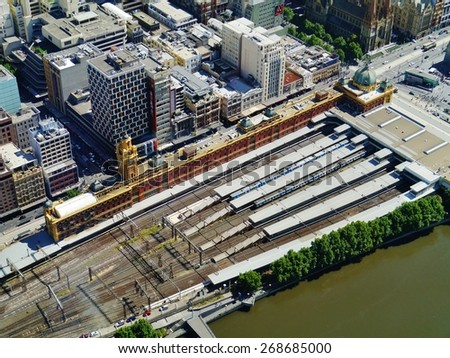 The railway yard with the platforms of the historic Flinders station in Melbourne in Victoria in Australia  - stock photo