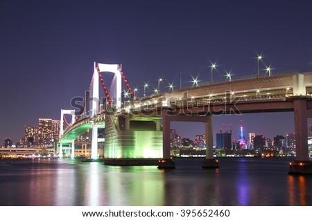 The rainbow bridge and Tokyo tower. Tokyo, Japan. - stock photo