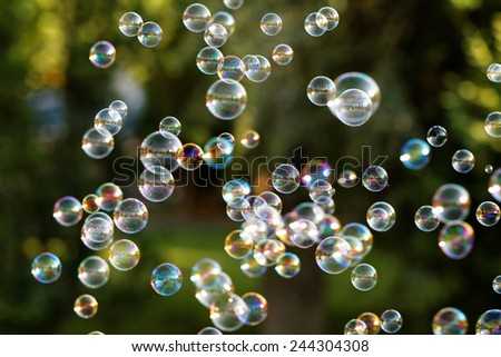 The rainbow bubbles from the bubble blower - stock photo
