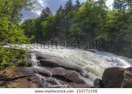 The rapids of Buttermillk Falls on the Raquette River in the Adirondacks Mountain of New York - stock photo