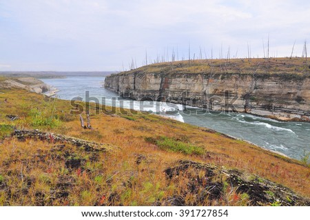 The rapids on the river. Summer landscape with rapids on the river Fish on the Taimyr Peninsula in Russia. - stock photo