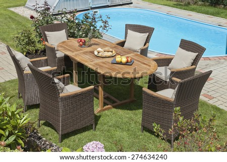 The rattan Garden furniture by the pool - stock photo