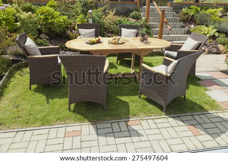 The rattan Garden furniture in the garden - stock photo