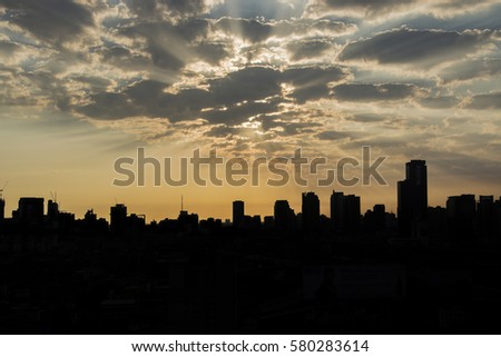 The rays of light with the silhouettes Bangkok city life