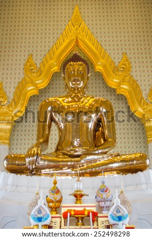 The real gold Buddha sculpture in the temple of Thaiand. - stock photo