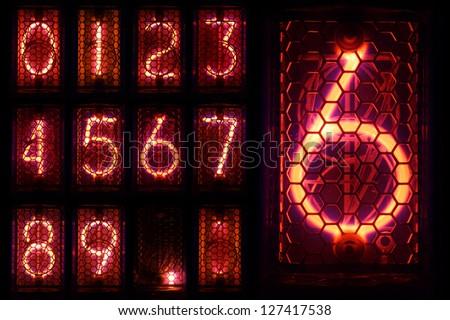 The real Nixie tube indicator a set of decimal digits. - stock photo