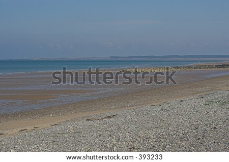 The receding tide on a beautiful deserted beach - stock photo