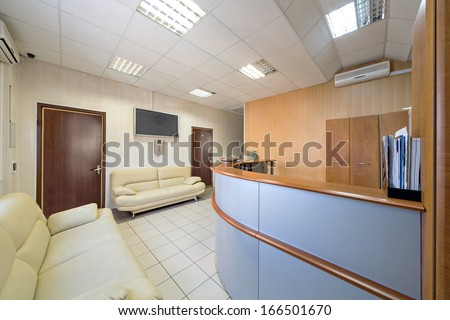 The reception with leather sofa and screen in a modern office building - stock photo