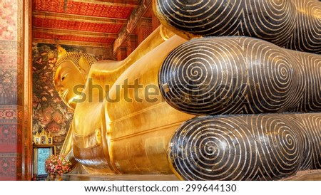 The Reclining Buddha at Wat Pho (Pho Temple) in Bangkok   - stock photo