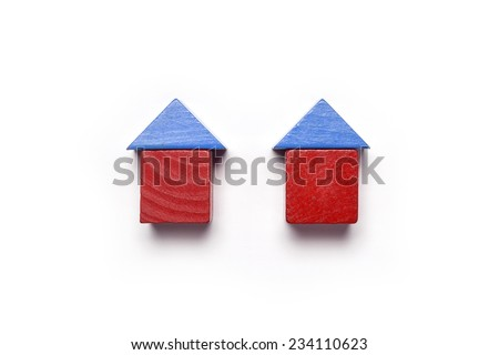 the red and blue wood blocks like house(real estate) isolated white, top view at the studio.