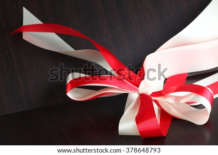 The red and white color fabric ribbon represent the gift and present background concept related idea.