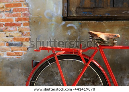 The Red bicycle beside the old city walls