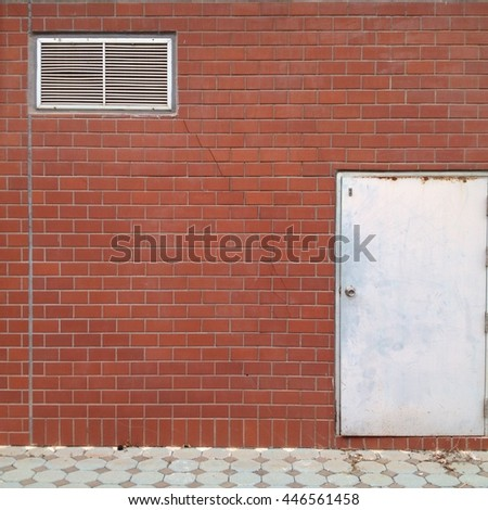 The Red brick wall and the iron closed door