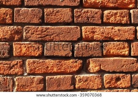 The red bricks. Wall of bricks. Texture of brick wall. The background of bricks. The old bricks. Old masonry. An old wall. - stock photo