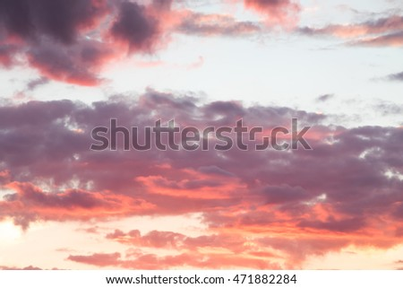 the red glow of sunset clouds sky