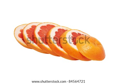 The red grapefruit is cut by segments. On a white background - stock photo