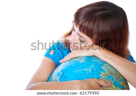 The red-haired girl is sleeping on the globe. Isolated on white background